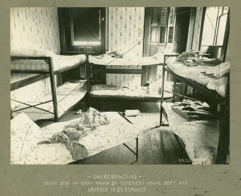 Photo of a tenement room in 1902 taken during an inspection by the New York City Tenement House Department