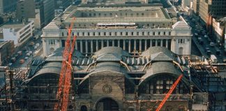 The demolition of Penn Station in the early 1960s. In the background, the James A. Farley Post Office, also designed by McKim, Mead & White, is viewed as a successor, though plans have moved slowly