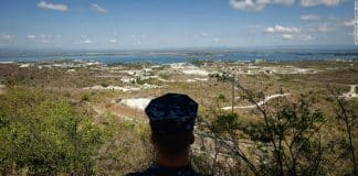 A Navy sailor surveys the U.S. naval base at Guantanamo Bay in October 2009. In December 2013, Congress passed a defense spending bill that makes it easier to transfer detainees out of the facility.