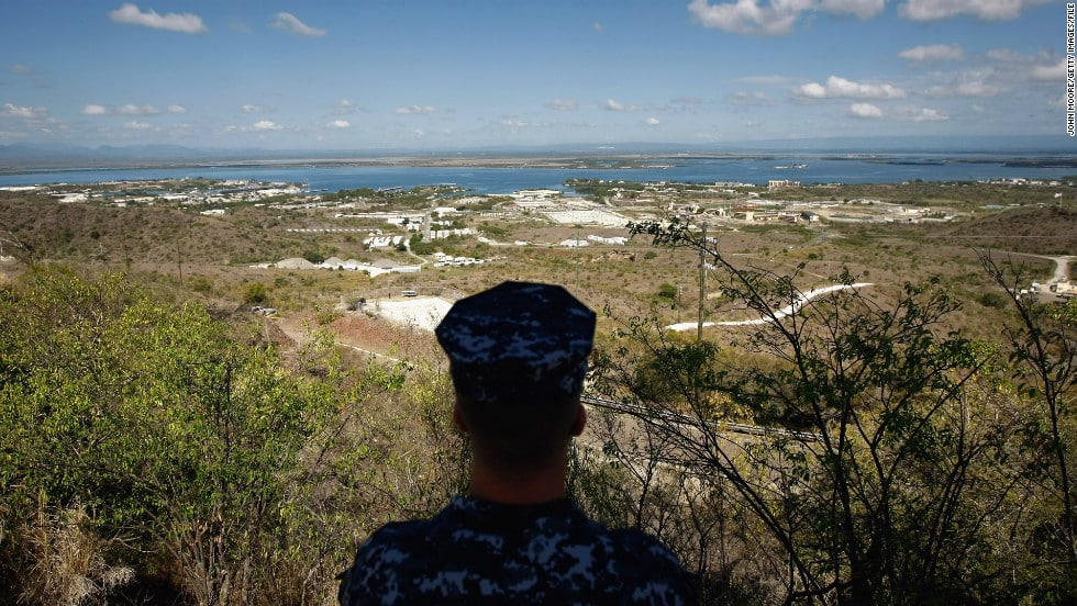 A navy sailor surveys the u. S. Naval base at guantanamo bay in october 2009. In december 2013, congress passed a defense spending bill that makes it easier to transfer detainees out of the facility.