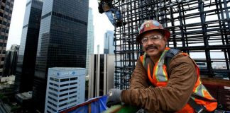 """Working 300 feet above downtown Los Angeles, ironworkers position reinforcing steel onto the walls of the New Wilshire Grand. """"This is dangerous work,"""" says foreman Otto Solis, """"but it can change your life."""""""