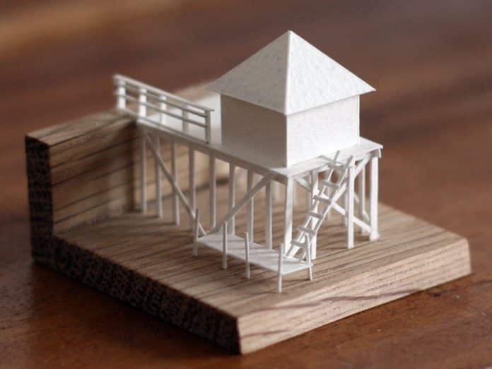 Every day, artist Charles Young creates a miniature building out of paper and glue