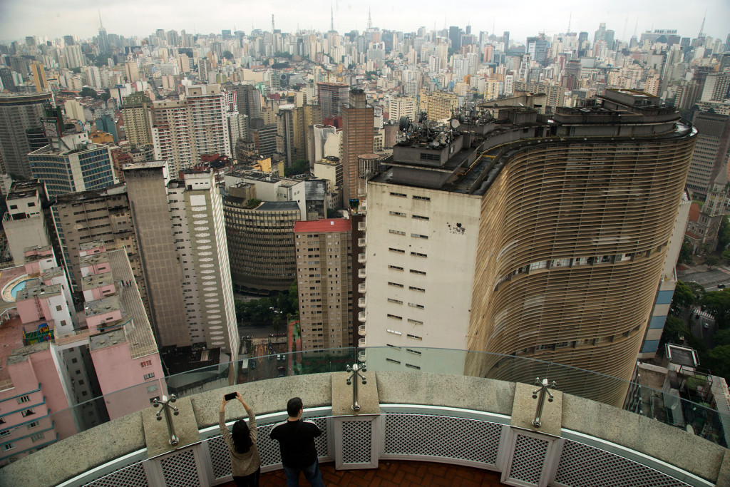 Visitors take pictures from the terrace of the Italia building in downtown Sao Paulo, Brazil, Tuesday, Nov. 26, 2013