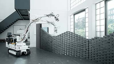 In-situ Fabricator, the autonomous construction robot capable of laying bricks into pre-programmed structures