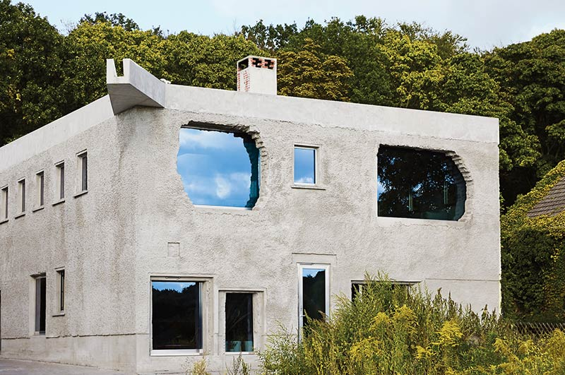 A Former German Underwear Factory, Now an Elegant Concrete Villa