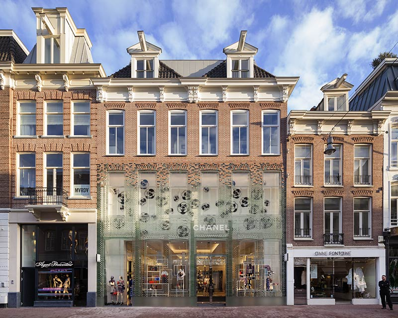 MVRDV complete Crystal Houses Amsterdam, a flagship store with a replica façade made entirely out of glass