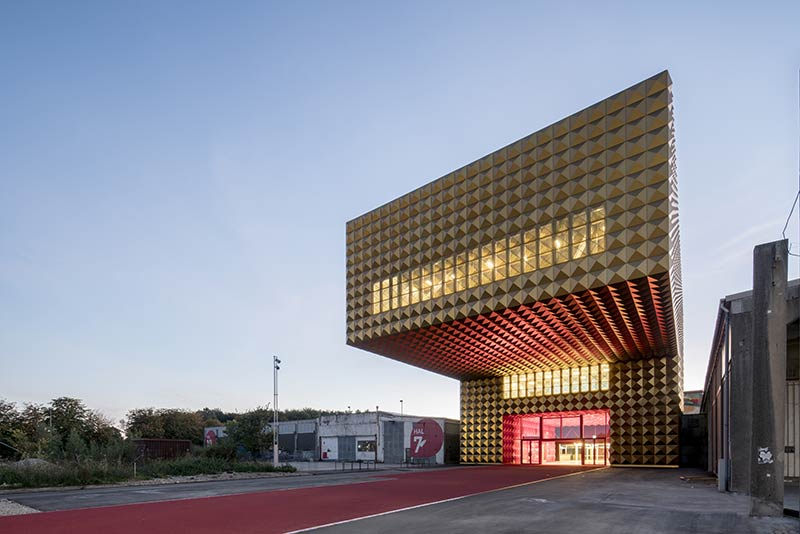 MVRDV and COBE open Ragnarock, a gold-studded, gravity-defying rock museum in Roskilde, Denmark