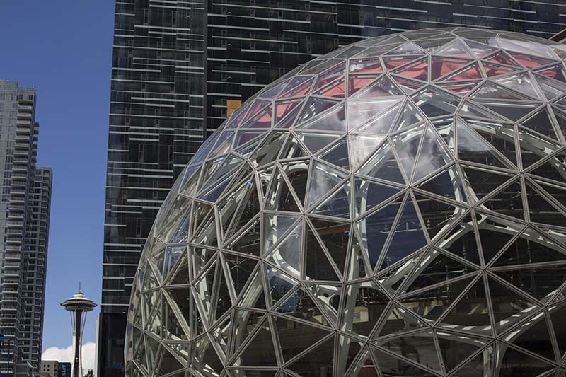 The Space Needle in Seattle, left, near Amazon's new office tower and spheres