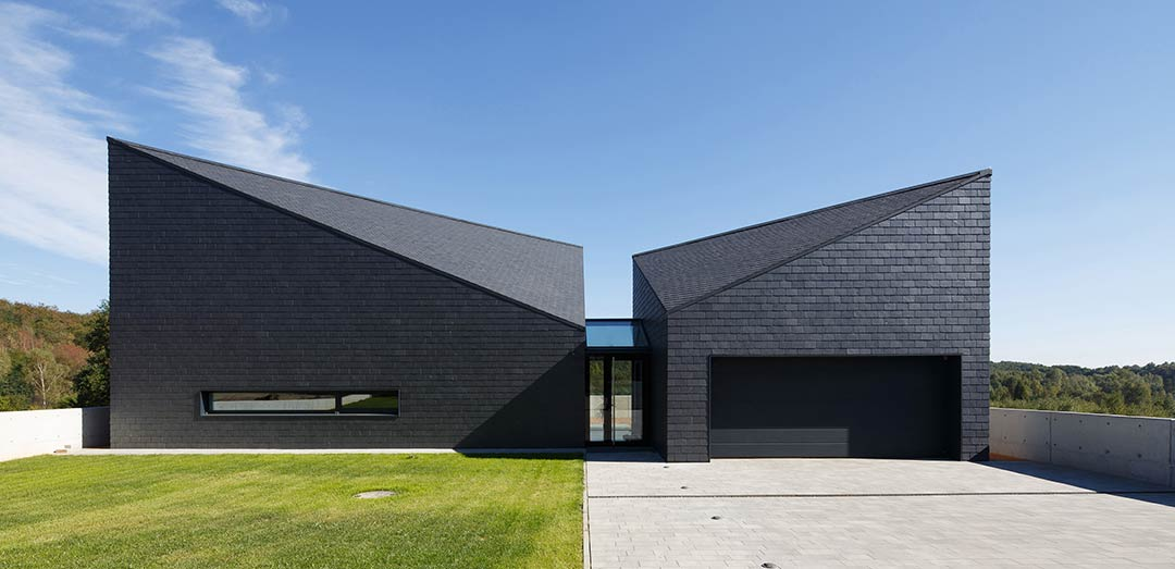 House in Krostoszowice / RS+ Robert Skitek
