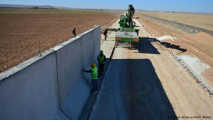 Turkey builds more than half of Syrian border wall