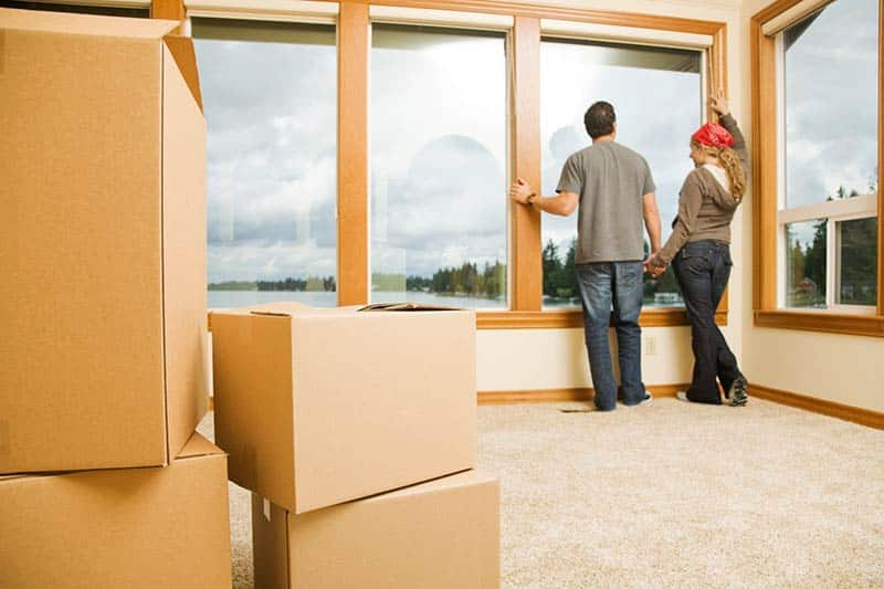 packing stuff when moving, truck loaded with furniture, unloading the truck, people carrying furniture, estimate of the moving service, moving company