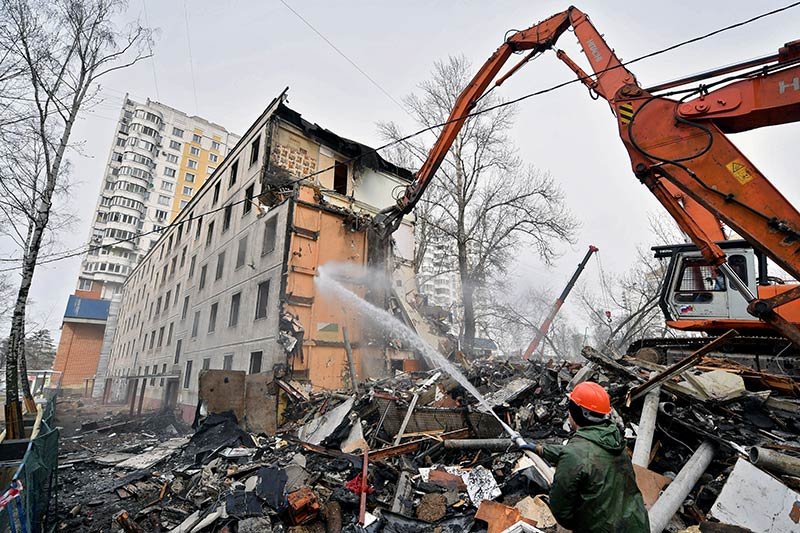 An excavator demolishes a five-storey apartment block in Moscow in April