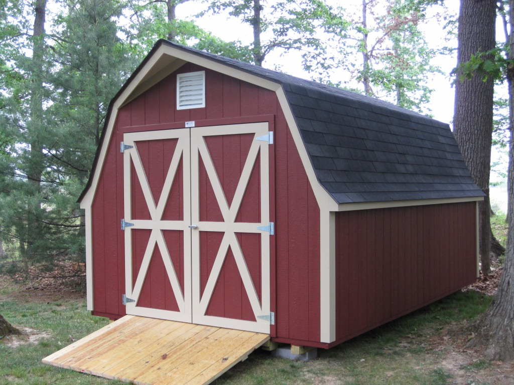 A Barn House Featuring A Gambrel Roof