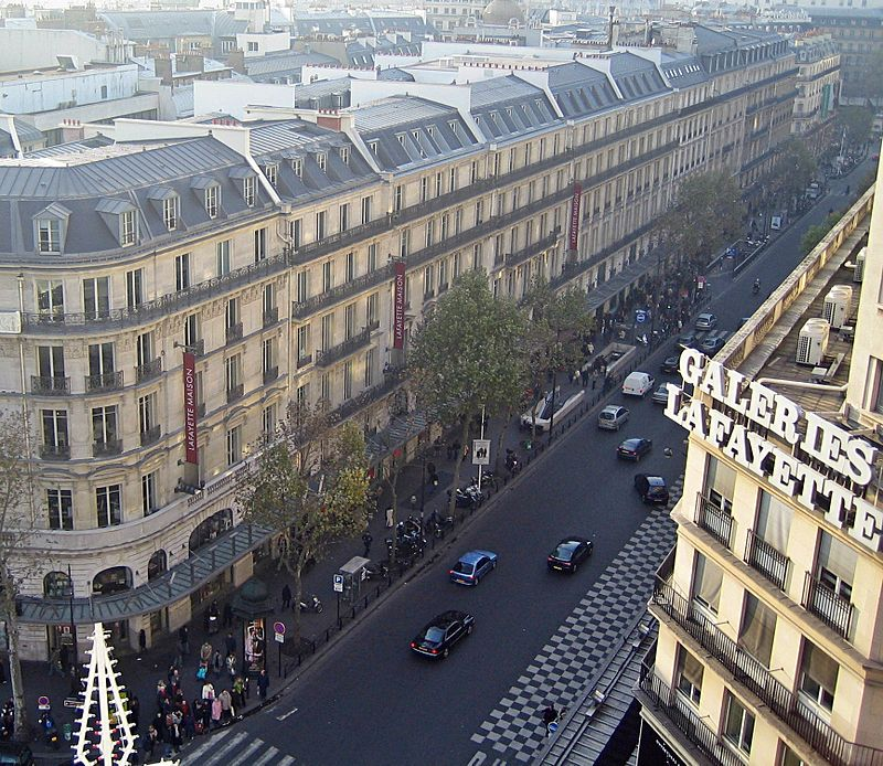 An Aerial View Of Mansard Rooftops Along Boulevard Haussmann In Paris