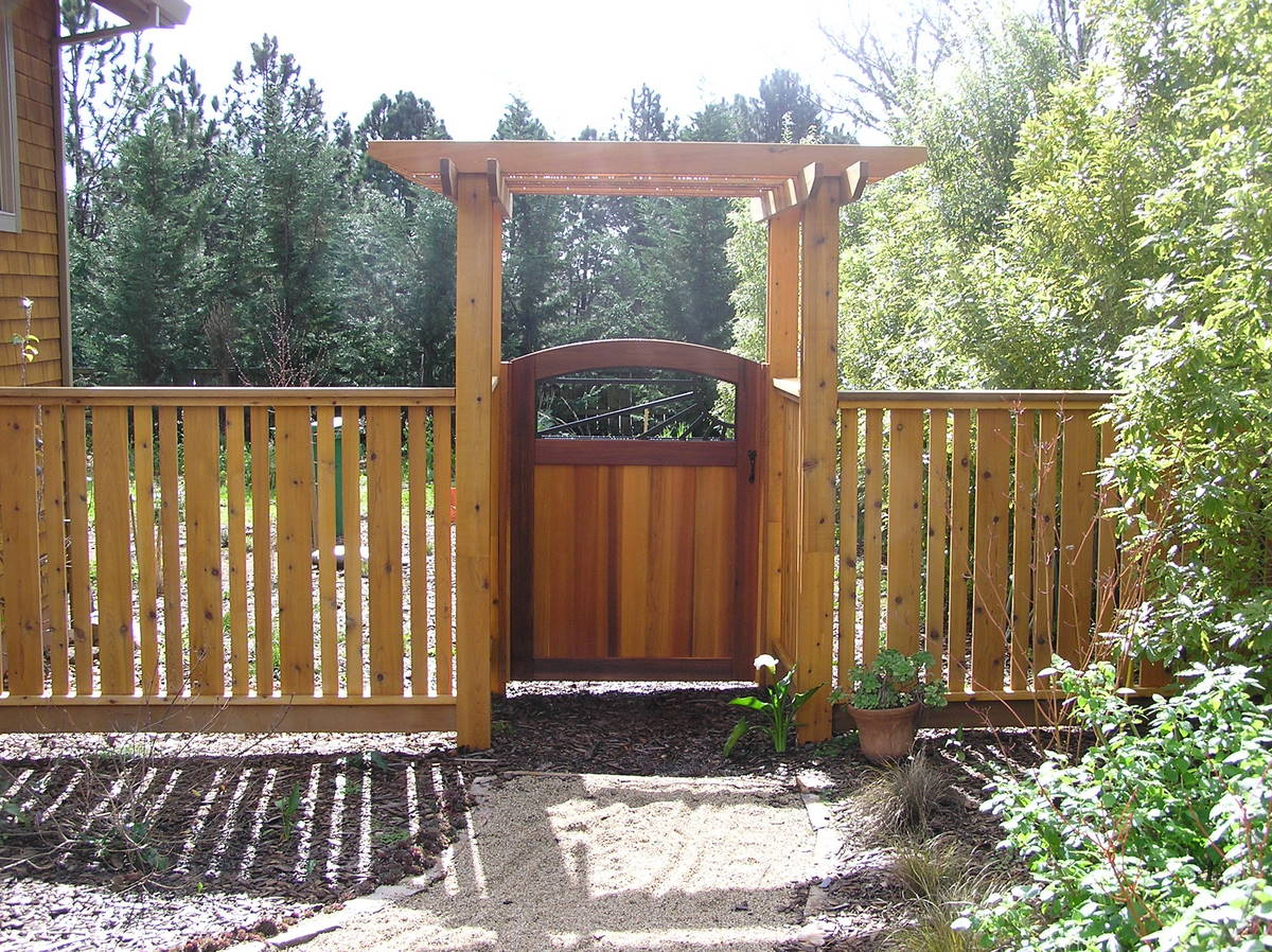 Fences & Gates Designs 33 brilliant home fence gate design ideas to protect your home in picture this a pebbly way that runs from your door to a sweet little wooden door that swivels on either side add a garden on either side and you will have workwithnaturefo