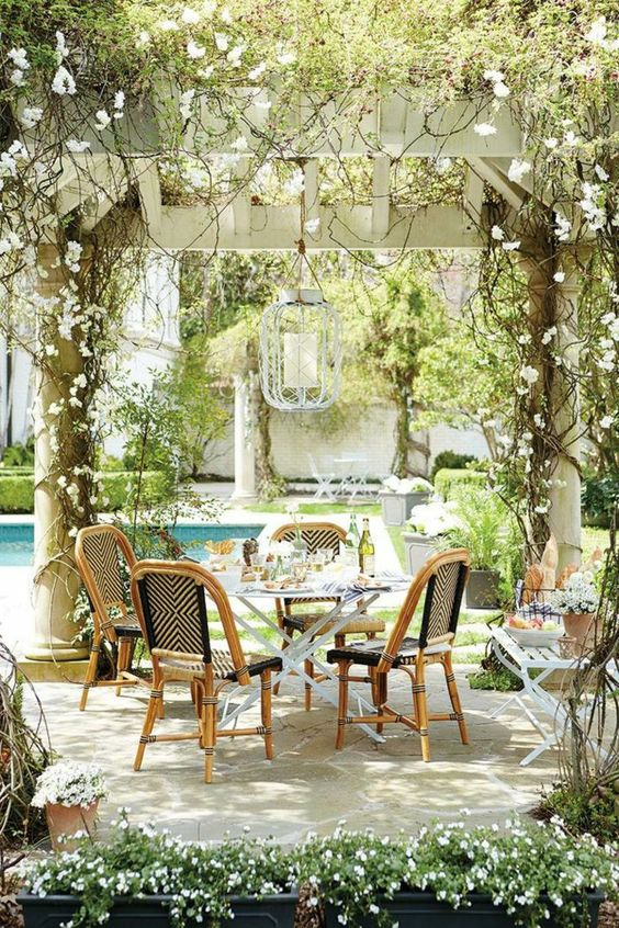Vines and flowers as centerpieces on a magical patio