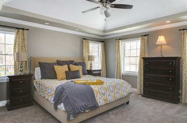 Curtains add geometric pattern to the bedroom
