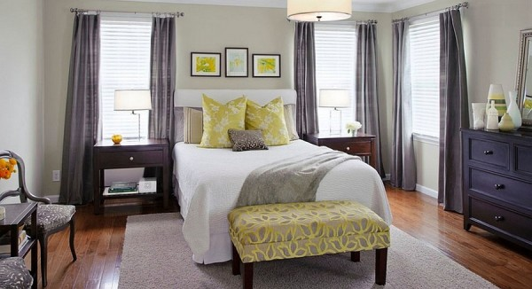 Stylish bench at the foot of the bed in yellow