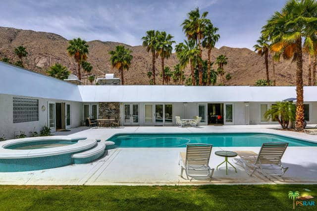 Mid century house with manicured grounds 1