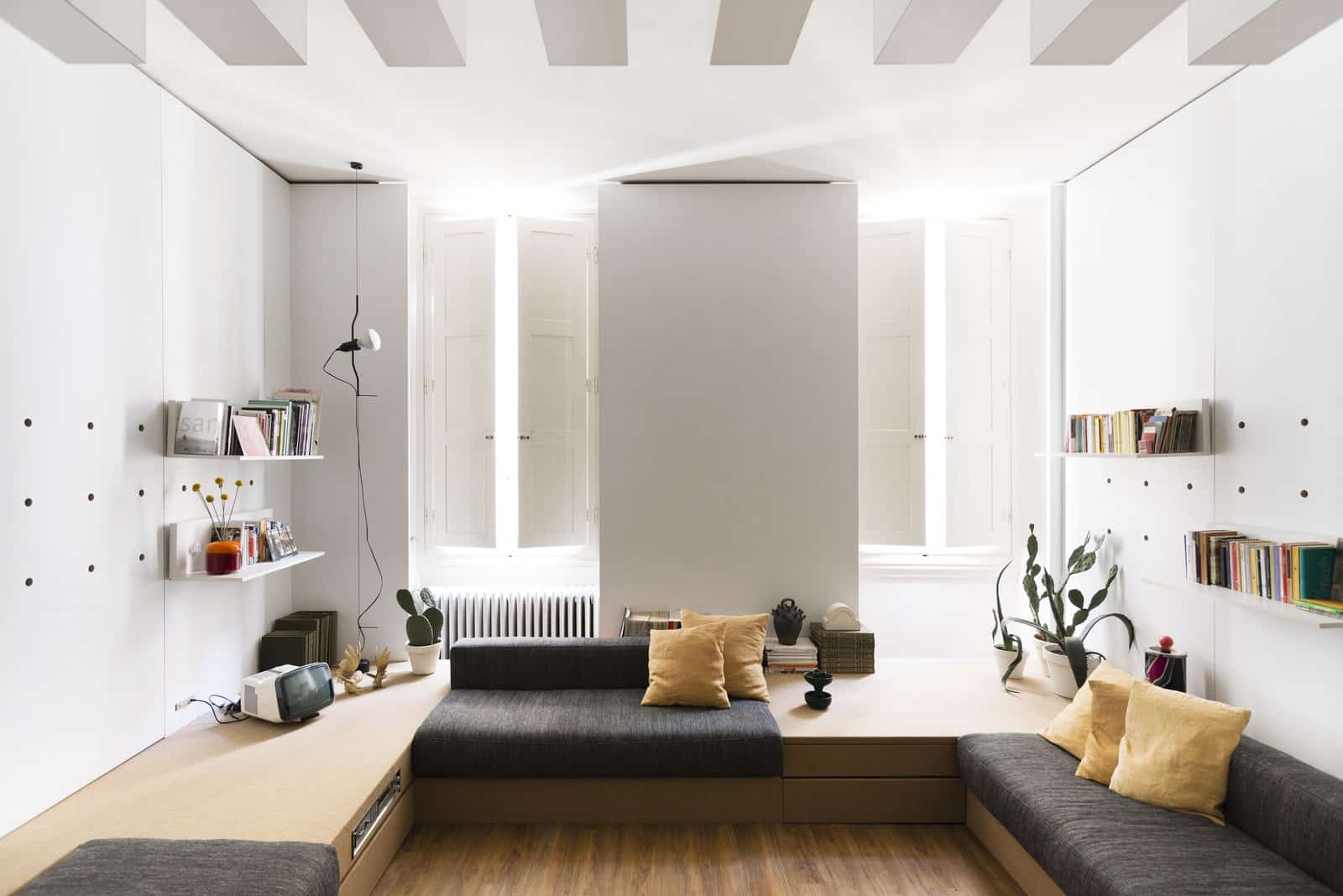 In the main living area are built in platforms with storage spaces and niches that can be filled with padding to create sofas or beds1