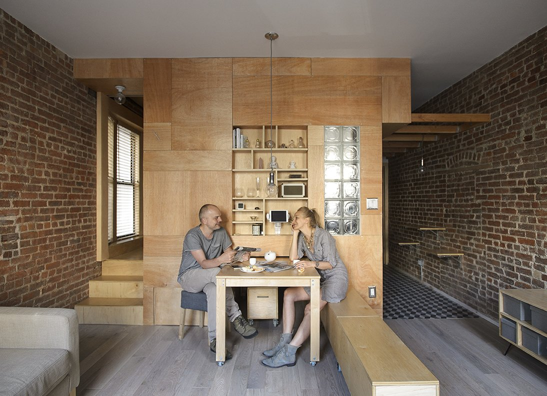 Peter and his wife artist olia feshina relax inside their apartment in new yorks washington heights2