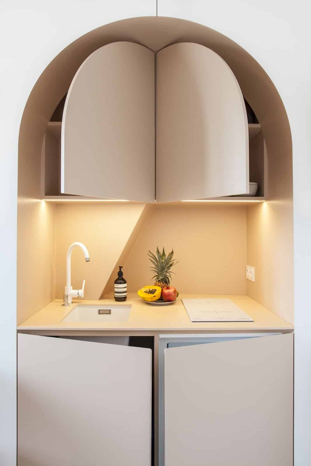 Pop out doors reveal storage space and a tiny refrigerator1