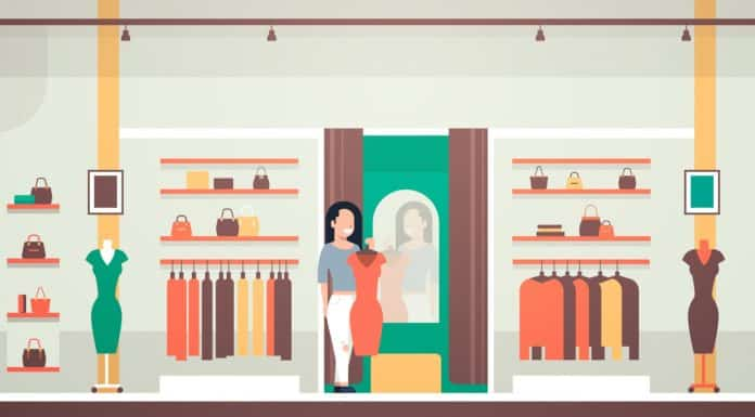 business woman trying on new dress elegant woman looking at mirror fashion shop female clothes market modern shopping mall interior flat horizontal