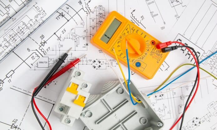 electrical drawings, switch, circuit breakers, cutting box and digital multimeter. installation of power supply systems
