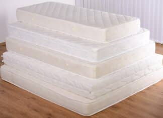 Many mattress in a pyramid in the room.
