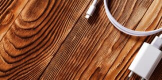 Cable phone chargers on wood background