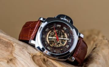 Close up of Luxury man wrist watches placed on timber in brown background