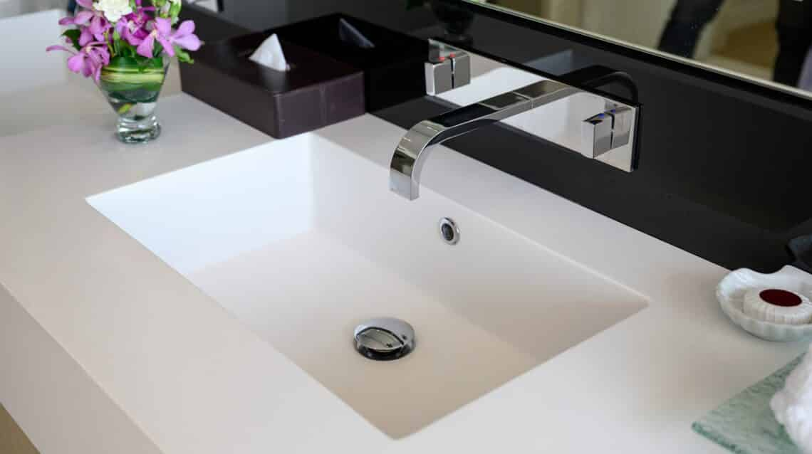 Modern luxury stainless faucet with ceramic sink of automatic sensor and cool with heat control button in bathroom