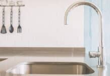 Faucet sink at kitchen - vintage light tone filter