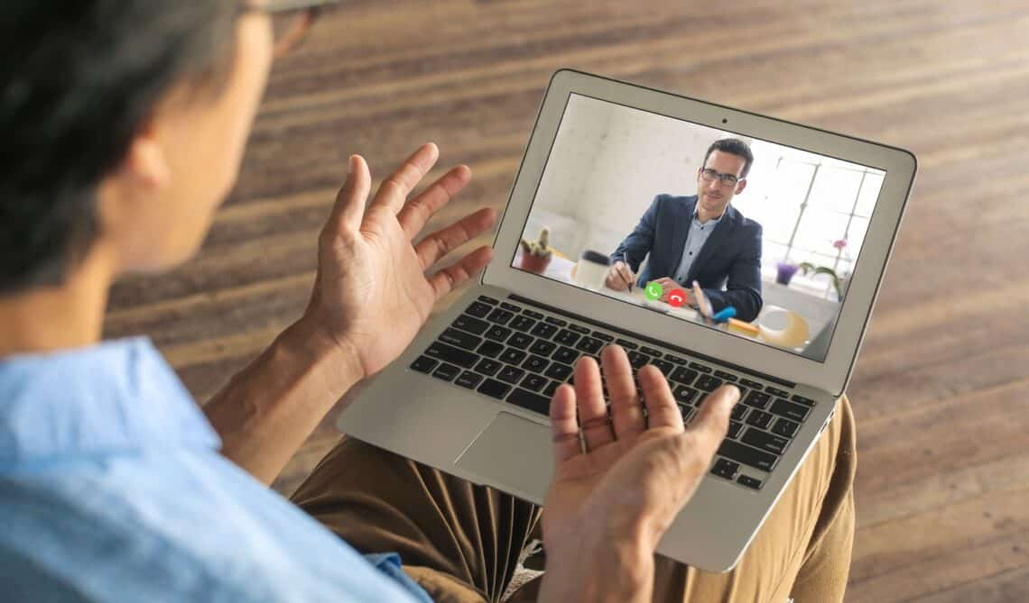 Man applying for a remote work. He is doing his interview on a video call.