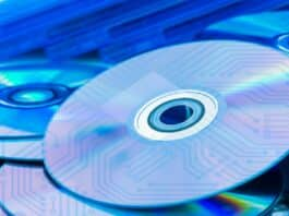 Closeup of a stack compact discs (CD/DVD) with the circuit board