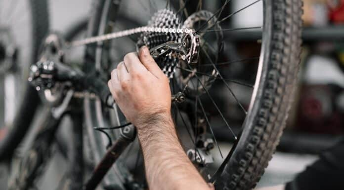 Bicycle mechanic in a workshop in the repair process .