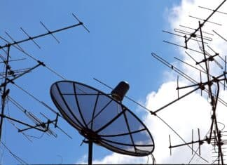 concpetual of satellite and antenna on blue sky