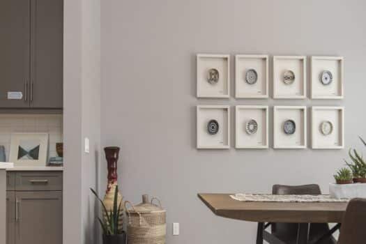 An interior shot of a modern house dining room with art on the wall