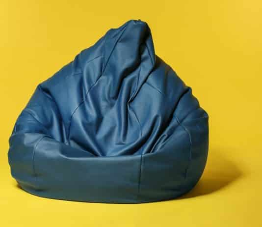 Beanbag chair on color background