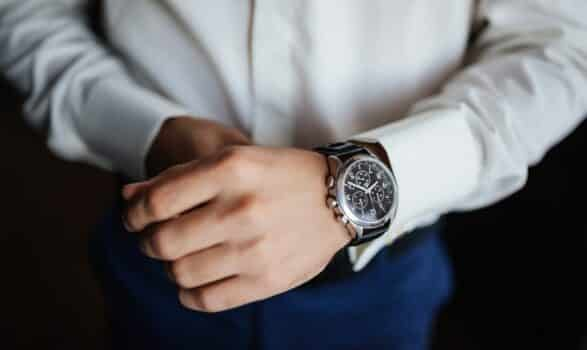 Rehearsal preparation. Groom's watches on hand. High angle view of groom, Fixing his watches before wedding.