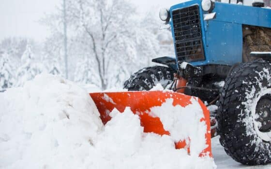 Utility equipment cleans the snow on the streets