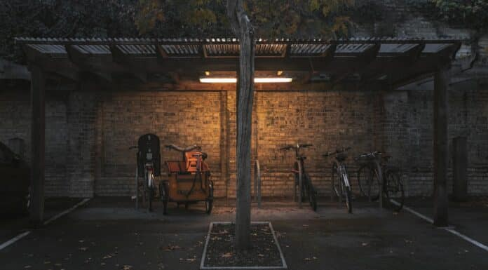 A wide shot of parked bicycles under a shed
