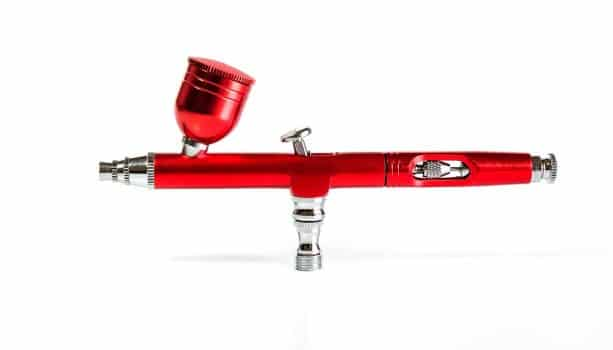 Red airbrush spray tool for paintingg hobby or work for art .