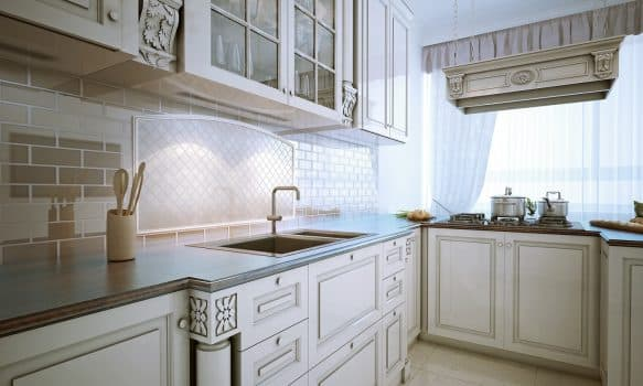 Inspiration for a traditional l-shaped eat-in kitchen with an undermount sink, recessed-panel cabinets, snowy-white cabinets, granite countertops, stone tile backsplash and stainless steel appliances.