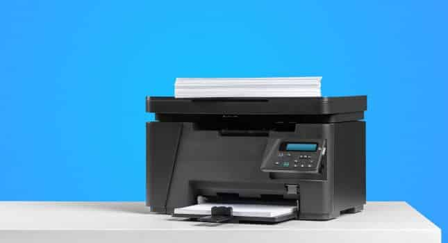 Printer copier machine on a bright colored background