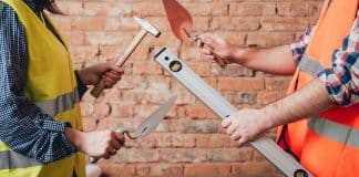 Hands holding tools for home renovation. Concept Background