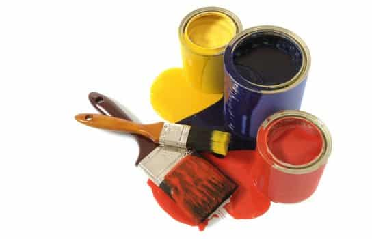 Messy dripping paint cans with paintbrushes isolated on a white background.