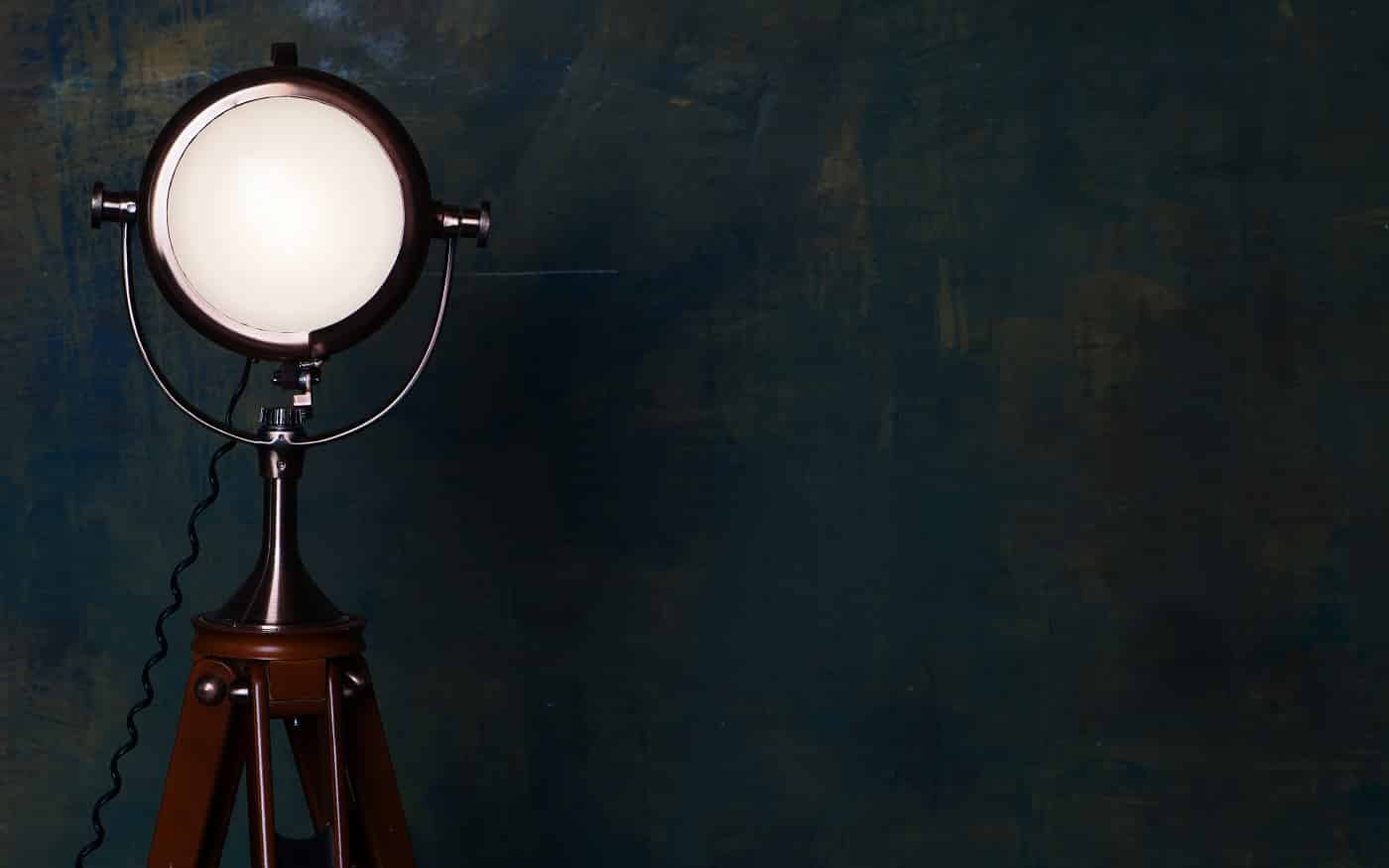 Vintage floor lamp over old wall