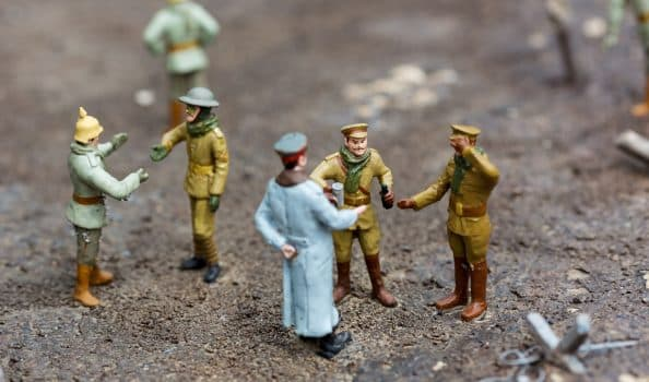 The officer and soldiers at a halt, miniature scene outdoor, europe. Mini figures with high detaling of objects, realistically diorama, toy model