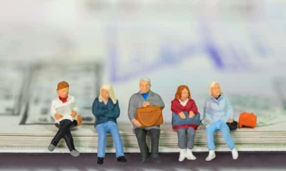 Travel and journey concept. Group of traveler businessman miniarure figure people sitting and waiting on passport with immigration stamped.